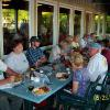Studebaker drivers enjoy good food and conversation on the patio at Extra Billy's