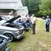 The group checking out Lee's Lark convertibles